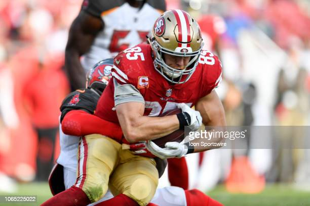 San Francisco 49ers tight end George Kittle is tackled after a reception during the second half of an NFL game between the San Francisco 49ers and...
