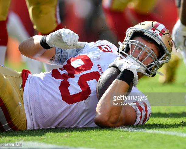 San Francisco 49ers Tight End George Kittle looks to see if he was able to get a first down during the first half of the season opener between the...