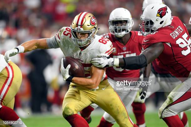 San Francisco 49ers tight end George Kittle runs past Arizona Cardinals defensive tackle Rodney Gunter in game action during an NFL game between the...