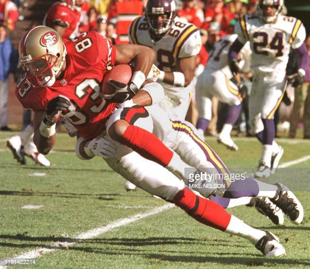 San Francisco 49ers tight end JJ Stokes makes a reception in front of the Minnesota Vikings defense for a gain of 16 yards during the first quarter...