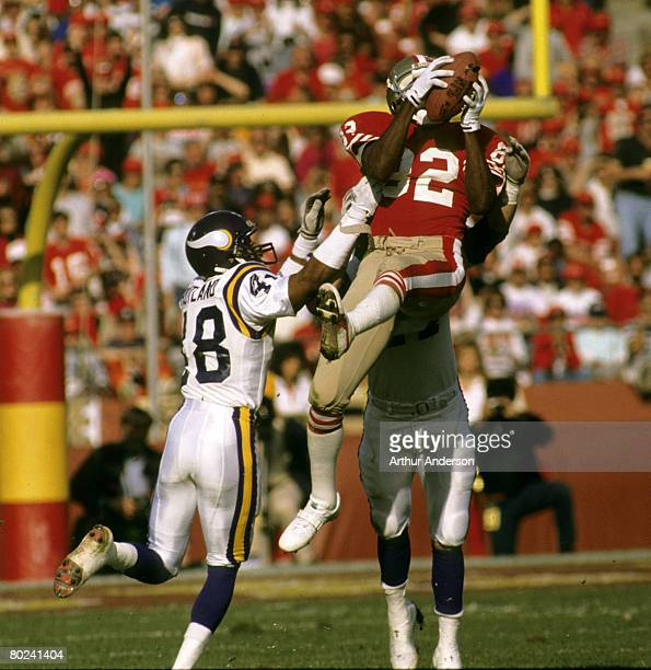 San Francisco 49ers wide receiver John Taylor leaps high to catch a pass as he takes a hit during the 49ers 4113 victory over the Minnesota Vikings...