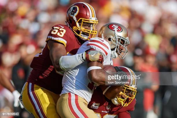 San Francisco 49ers wide receiver Pierre Garcon battles with Washington Redskins linebacker Zach Brown and Washington Redskins defensive back DJ...