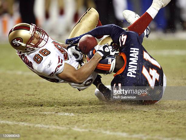 San Francisco 49ers wide receiver Taylor Jacobs can't hang on to the ball as he is tackled by Denver Broncos cornerback Karl Paymah The San Francisco...
