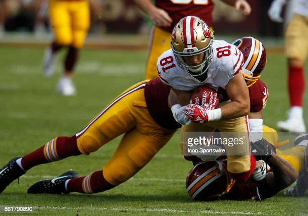 San Francisco 49ers wide receiver Trent Taylor is hit and tackled by Washington Redskins linebackers Chris Carter and Mason Foster during a football...