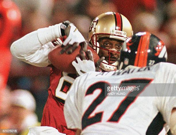 San Francisco 49'ers widereceiver Jerry Rice hauls in a catch for his first touchdown catch as Denver Broncos safety Steve Atwater tries to defend 15...