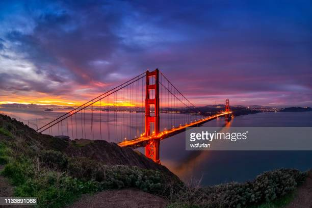 san francisco bay and golden gate bridge at sunrise. - golden gate bridge stock pictures, royalty-free photos & images
