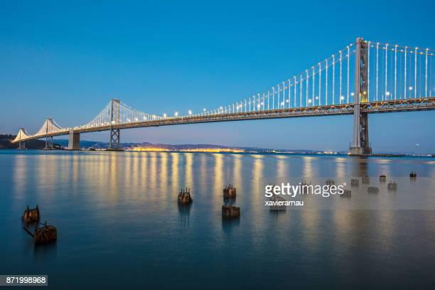 san francisco bay bridge at dusk - bay bridge stock pictures, royalty-free photos & images