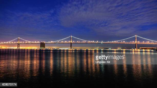san francisco bay bridge at dusk with reflection - bay bridge stock pictures, royalty-free photos & images