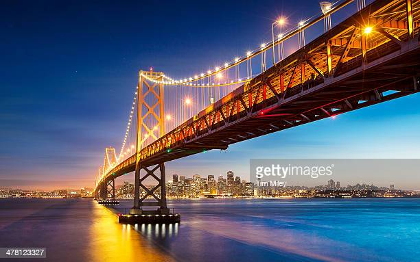 san francisco bay bridge evening - bay bridge stock pictures, royalty-free photos & images