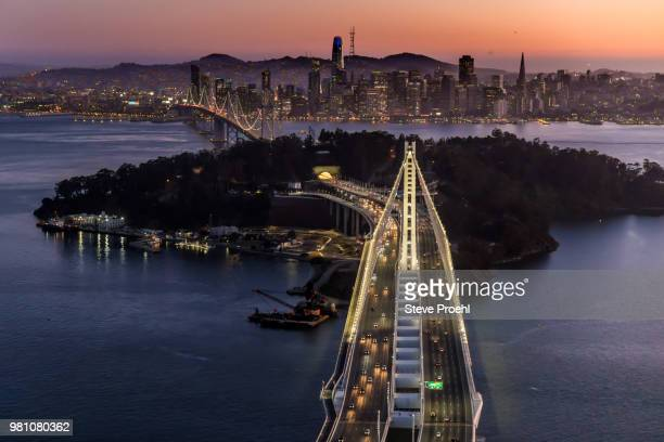san francisco bay bridge twilight - treasure island california stock pictures, royalty-free photos & images