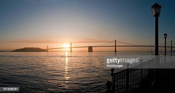 san francisco bay sunrise bridge pier panorama california - bay bridge stock pictures, royalty-free photos & images