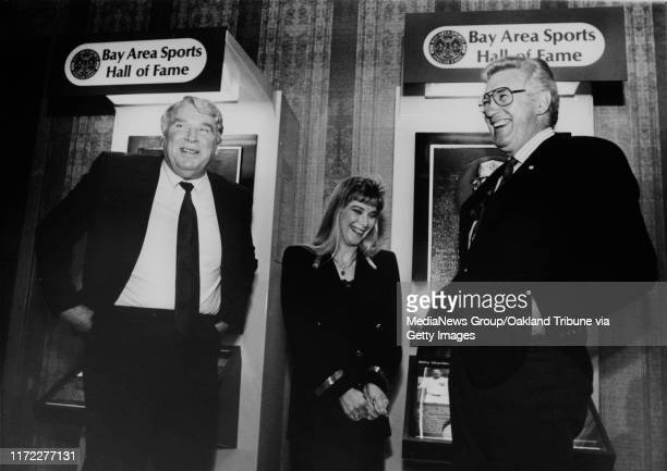 Jilluann Martin widow of Billy Martin shares a laugh with John Madden left and Bob St Clair at the induction of Martin to the Bay Area Sports Hall of...