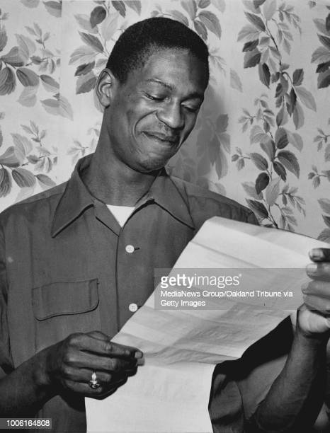 San Francisco CA February 26 1955 Bill Russell University of San Francisco center reads the United Press story annoucing his selection to the...