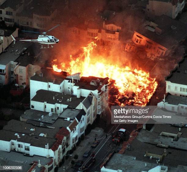 San Francisco, CA October 17, 1989: A fire roars in the Marina District after the Loma Prieta earthquake. Photo was taken from a helicopter.