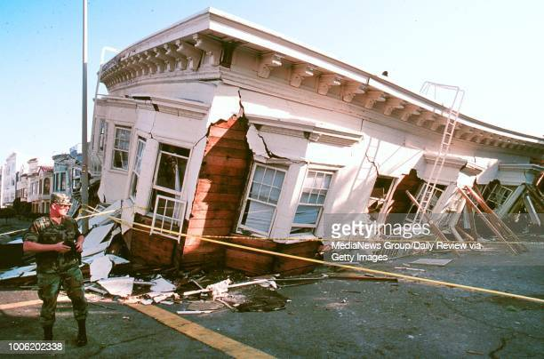 At dawn following the Loma Prieta earthquake in the Marina District military Police stand guard protecting the possessions of those who lost their...