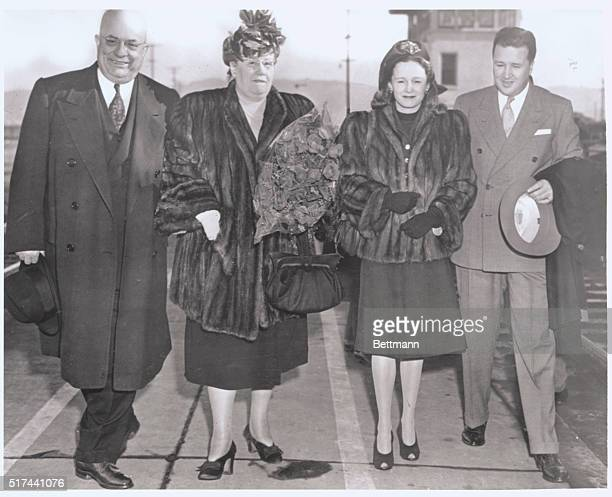 San Francisco California Automobile Industry Heads Meet Mr and Mrs Henry Kaiser and Mr and Mrs Henry Ford II arrive in San Francisco after meeting...