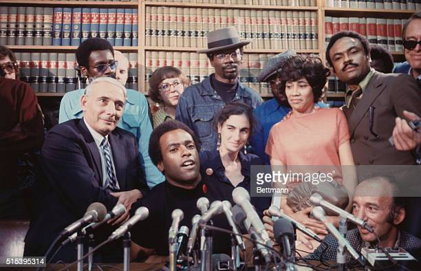 San Francisco California Black Panther leader Huey P Newton at press conference in office of his attorney Charles Garry August 5 1970 At right is...