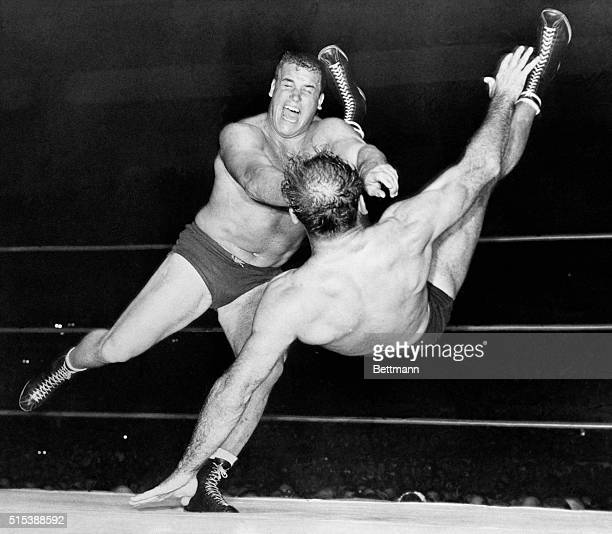 San Francisco, California: Football star Leo Nomellini throws wrestling champion Lou Thesz during world's heavyweight title match at the Cow Palace...