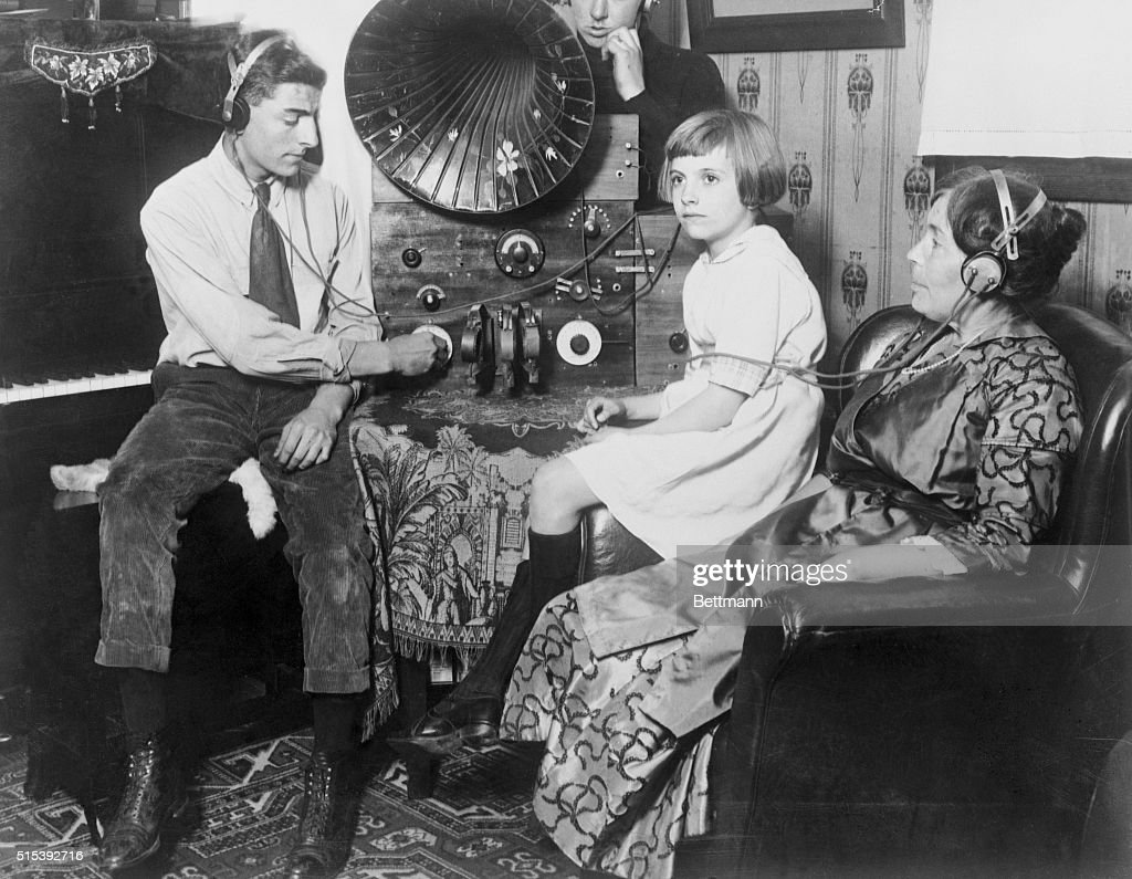 Family Listening to a Radio : News Photo