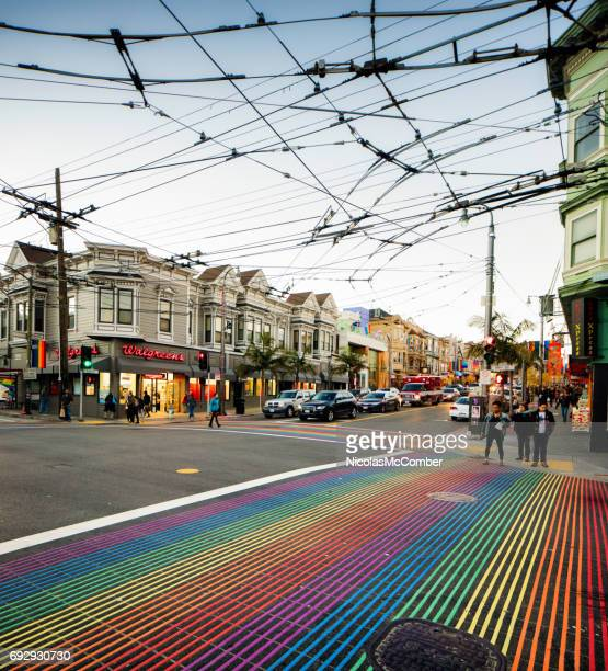 san francisco castro street gay district city scene with rainbow crosswalks - castro district stock pictures, royalty-free photos & images