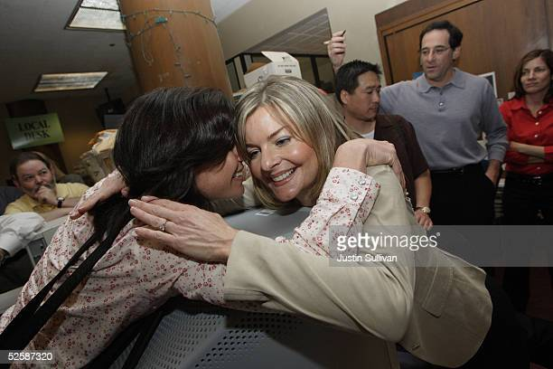 San Francisco Chronicle photographer Deanne Fitzmaurice hugs reporter Merideth May after Fitzmaurice won the Pulitzer Prize in feature photography...