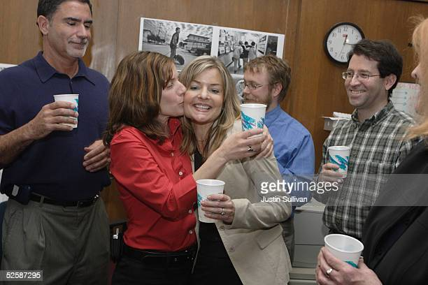 San Francisco Chronicle photographer Deanne Fitzmaurice is kissed by photo editor Kathleen Hennessy as Fitzmaurice celebrates winning the Pulitzer...