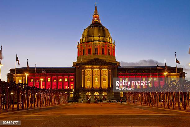 San Francisco City Hall building lit red and orange as the San Francisco 49rs were getting ready to play the Green Bay Packers in the NFL playoffs