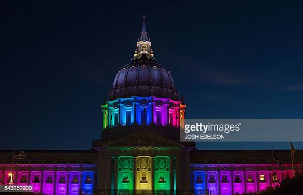 San Francisco City Hall is lit up in rainbow colors following Gay Pride in San Francisco California on Sunday June 2016 / AFP / Josh Edelson