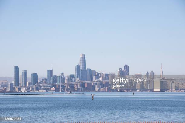 san francisco city skyline across the bay - oakland california skyline stock pictures, royalty-free photos & images
