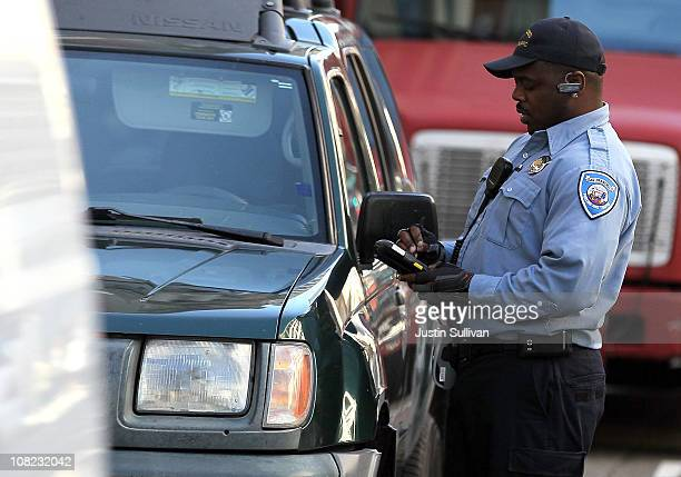 San Francisco Department of Parking and Traffic issues a parking ticket for an illegaly parked car on January 21 2011 in San Francisco California In...