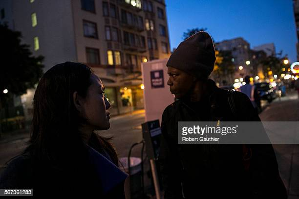 SAN FRANCISCO CA TUESDAY JANUARY 20 2015 San Francisco district 6 supervisor Jane Kim left talks with Mischa Fisher at the corner of Turk and Hyde...