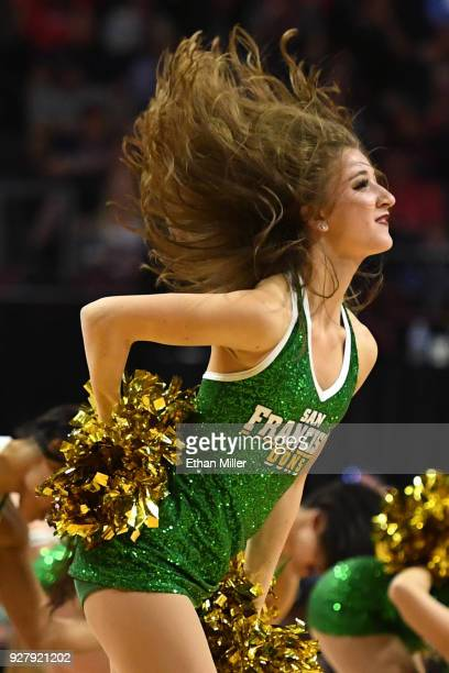 San Francisco Dons cheerleader performs during the team's semifinal game of the West Coast Conference basketball tournament against the Gonzaga...
