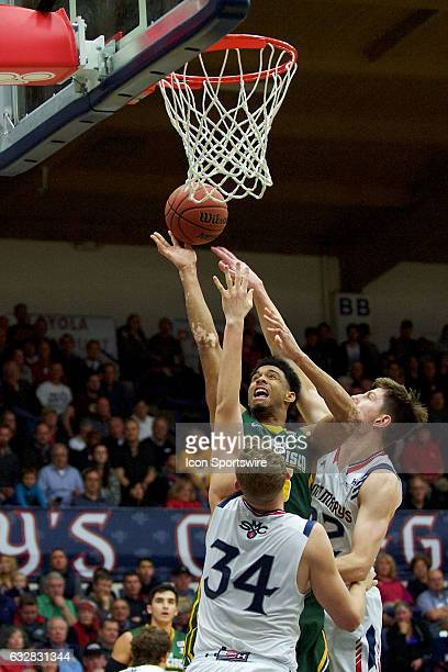 San Francisco Dons forward Nate Renfro shoots over St Mary's Gaels center Jock Landale and St Mary's Gaels forward Dane Pineau during the first half...