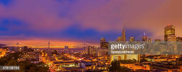 San Francisco downtown and Bay Bridge under low fog Panorama