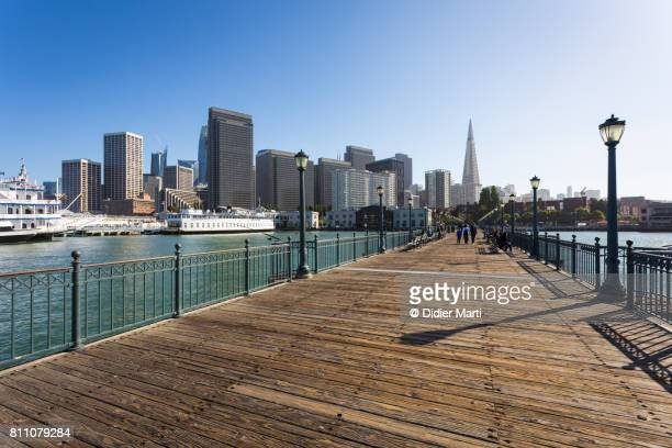 San Francisco downtown district from a jetty in the harbor area near Embarcadero in California famous city