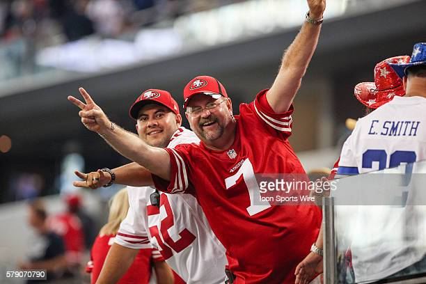 San Francisco fans cheer on their team during the NFL season opener football game between the Dallas Cowboys and San Francisco 49ers at ATT Stadium...