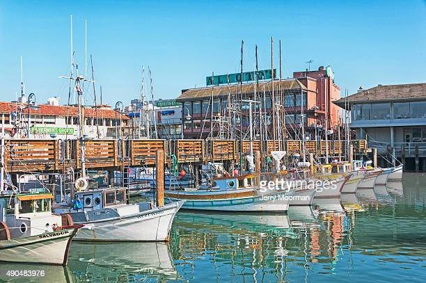san francisco fishermans wharf with boat in a row - fishermans wharf stock pictures, royalty-free photos & images
