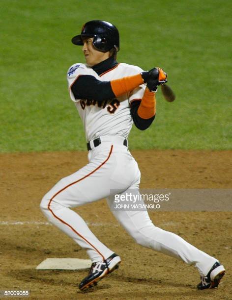 San Francisco Giant Tsuyoshi Shinjo hits the ball and reached first on a fielding error in the ninth inning of Game Five of the World Series in San...