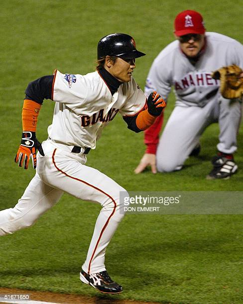 San Francisco Giant Tsuyoshi Shinjo runs to first on a bunt as Anaheim Angels pitcher Ben Weber makes the play to first in the seventh inning of Game...