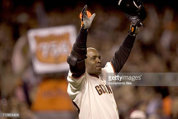 San Francisco Giants' Barry Bonds celebrates home run number 756 to break Hank Aaron's home run record in the fifth inning against the Washington...