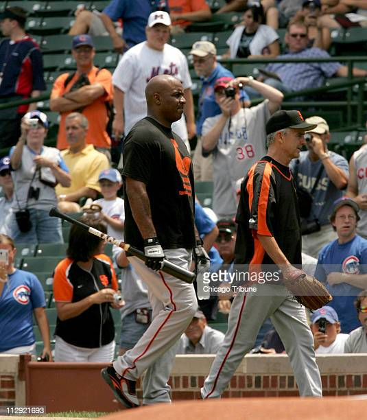 San Francisco Giants Barry Bonds comes in from the indoor batting cage at Wrigley Field in Chicago Illinois Wednesday July 18 2007