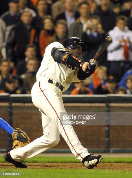 San Francisco Giants Barry Bonds follows through hitting his 500th career homerun against the Los Angeles Dodgers 17 April 2001 in San Francisco...