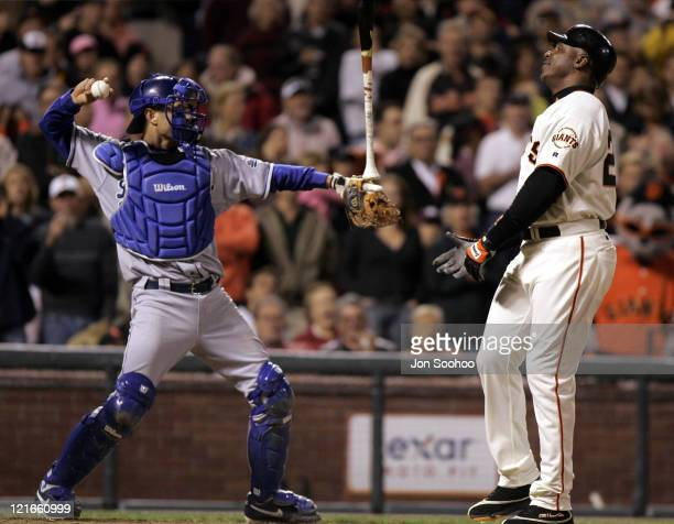 San Francisco Giants Barry Bonds strikes out as Los Angeles Dodgers catcher Brent Mayne throws to third September 24 2004 at SBC Park in San...