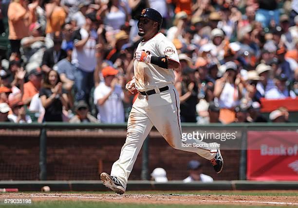 San Francisco Giants base runner Hector Sanchez scores on teammate's Brandon Crawford's base hit single during a Major League Baseball game between...