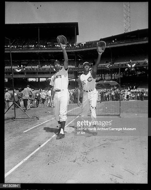 San Francisco Giants baseball player and Cincinnati Reds player no 20 Frank Robinson posing on Forbes Field with gloves upraised Pittsburgh...