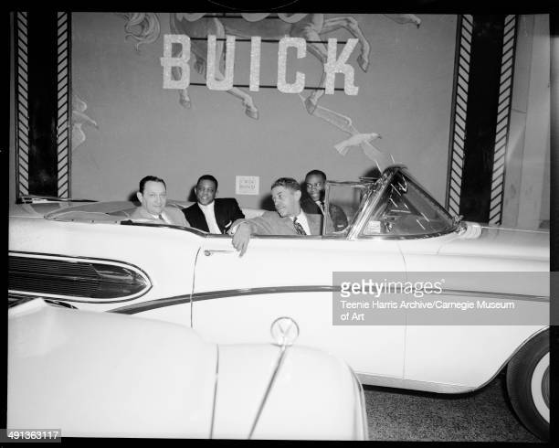 San Francisco Giants baseball player Willie Mays with Monte Irvin Mal Goode and another man seated in Air Born B58 Buick convertible car Pittsburgh...
