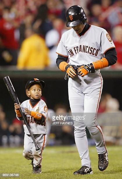 San Francisco Giants' batboy Darren Baker carries the bat of Tsuyoshi Shinjo after he struck out swinging in the ninth inning of Game Seven of the...