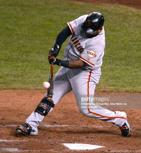 San Francisco Giants batter Pablo Sandoval hits a double in the fourth inning of Game 2 of baseball's World Series against the Kansas City Royals at...