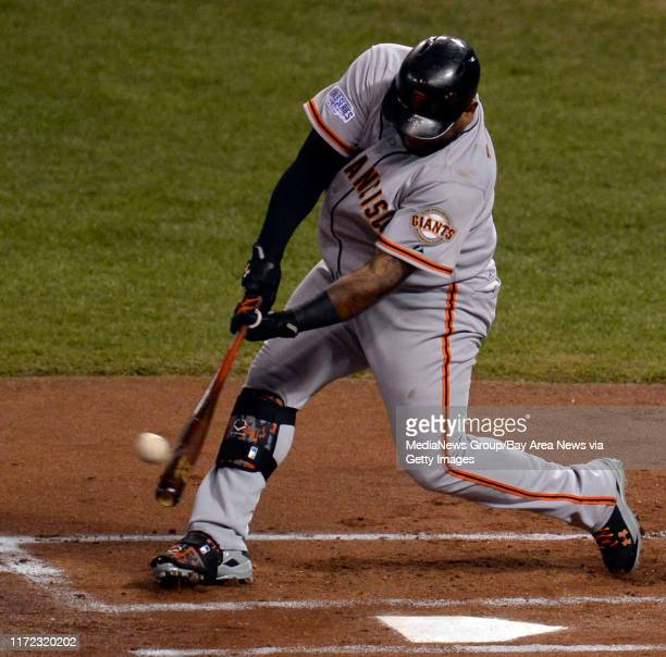 San Francisco Giants batter Pablo Sandoval hits a line drive double to right field scoring teammate Gregor Blanco in the first inning of Game 1 of...