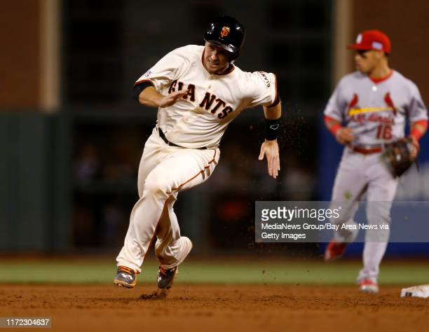 San Francisco Giants' Buster Posey heads to third base on a San Francisco Giants' Pablo Sandoval single against the St Louis Cardinals in the sixth...